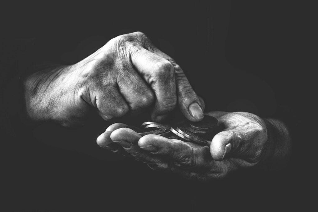 Foto Hände mit Geld